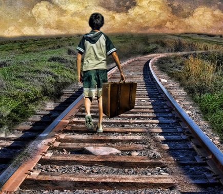 Boy on tracks with suitcase